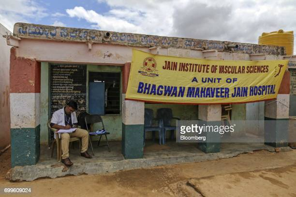 A member of the medical staff from the Jain Institute of Vascular Sciences prepares paperwork outside a school at Pancharala on the outskirts of...