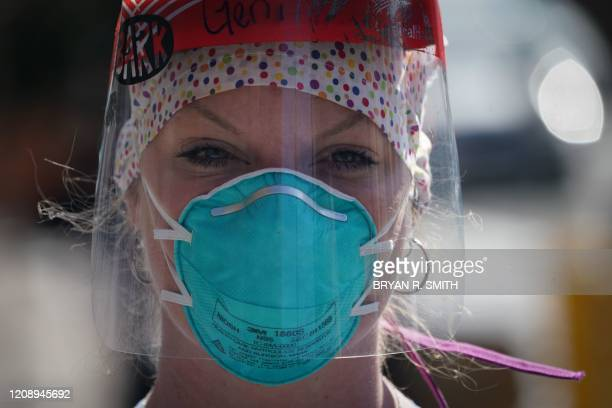 A member of the medical staff listens as Montefiore Medical Center nurses call for N95 masks and other critical PPE to handle the coronavirus...