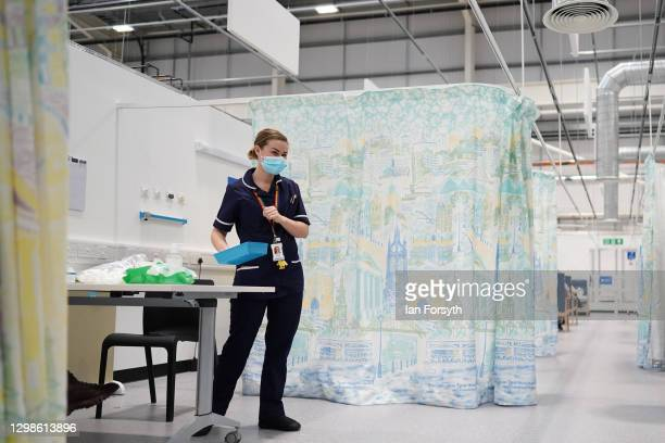 Member of the medical staff waits for her next patient at the NHS Nightingale North East hospital on January 26, 2021 in Sunderland, England. The...