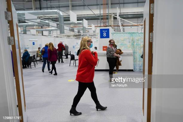 Member of the medical staff walks through the consulting area at the NHS Nightingale North East hospital on January 26, 2021 in Sunderland, England....