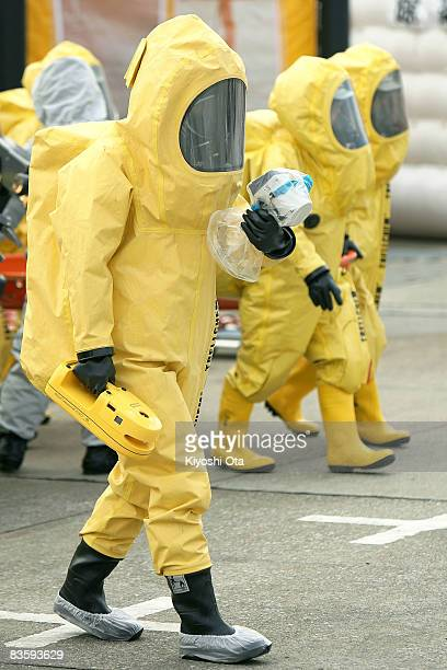 A member of the Metropolitan Police Department dressed in a chemical protection suit determines the radiation danger zone during an antiterrorism...