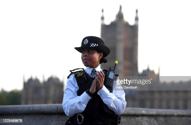 A member of the Metropolitan Police takes part in the applause on Westminster Bridge on May 07 2020 in London England United Kingdom Following the...