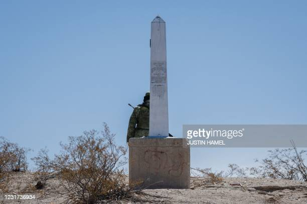 Member of the Mexican Guard stands guard at the border between the United States and Mexico following the House GOP Congressional Delegation to the...
