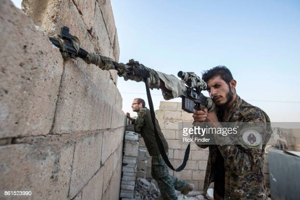A member of the MFS scans the area for ISIS positions from the roof of their nocter on August 17 2017 on the western front lines of Raqqa Syria The...