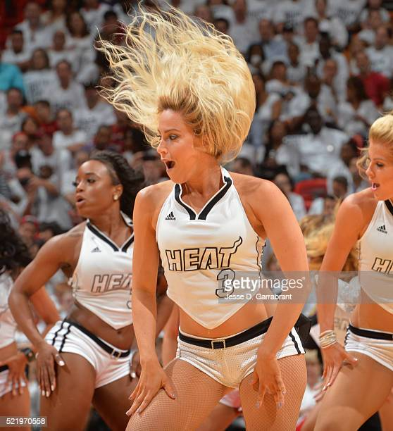 A member of the Miami Heat dance team performs for the crowd against the Charlotte Hornets during the Eastern Conference playoffs First Round Game...