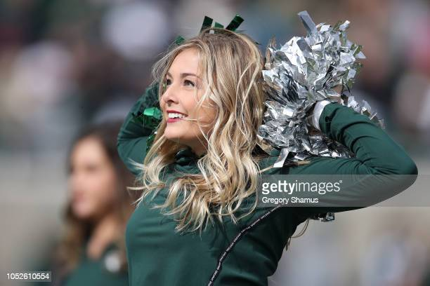 A member of the Michigan State Spartans dance team performs during a game against the Michigan Wolverines at Spartan Stadium on October 20 2018 in...