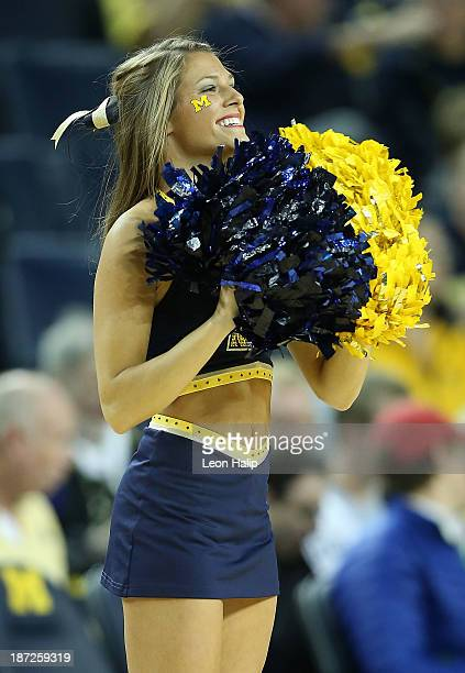 A member of the Michigan Wolverines cheerleader squad performs during the game between the University of Michigan and Wayne State University at...