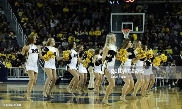 A member of the Michigan Wolverines dance team entertains the fans during the game against the Chattanooga Mocs at Crisler Center on November 23 2018...