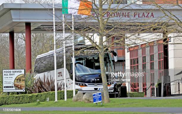 Member of the military baords the bus after escorting airline passengers to the Crowne Plaza hotel to begin their period of quarantine on March 29,...