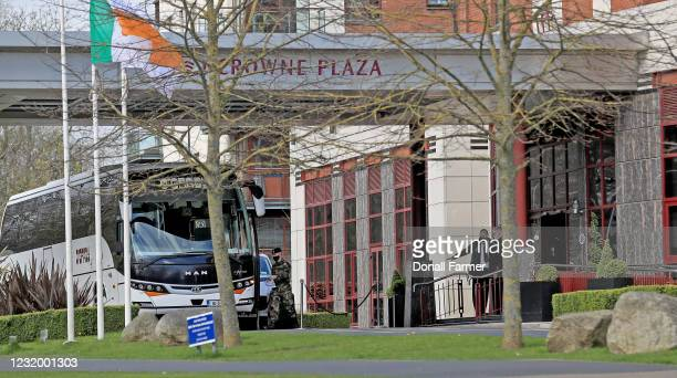 Member of the military boards the bus after escorting airline passengers to the Crowne Plaza hotel to begin their period of quarantine on March 29,...