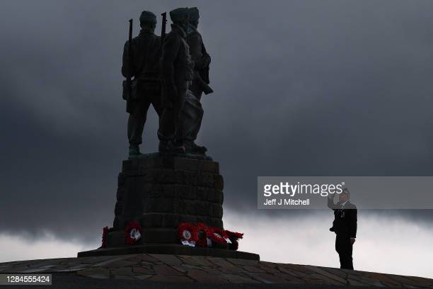 Member of the military lays a wreath at Commando Memorial to commemorate and pay respect to the sacrifice of service men and women who fought in the...