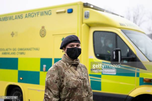 Member of the military poses for a photograph with an ambulance at Maindy Barracks on December 23, 2020 in Cardiff, Wales. The Welsh Ambulance...
