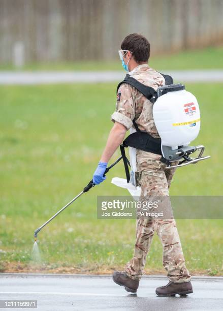A member of the military sprays disinfectant at a Covid19 testing centre in Boston Lincolnshire as the UK continues in lockdown to help curb the...