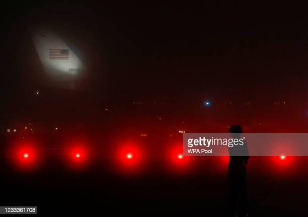 Member of the military stands on the tarmac as U.S. President Joe Biden and first lady Jill Biden arrive on Air Force One at Cornwall Airport...