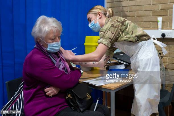 Member of the military vaccinates a woman at the COVID-19 mass vaccination centre at Pentwyn Leisure Centre on February 3, 2021 in Cardiff, Wales....