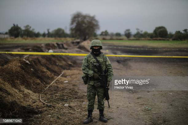 Member of the Military watches over the explosion area of the pipeline on January 20 2019 in Tlahuelilpan Mexico In a statement PEMEX announced that...