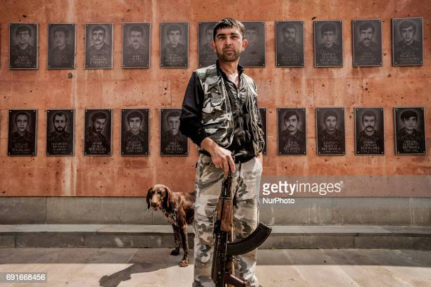 Member of the militia of Nagorno Karabakh poses in front the memorial of the soldiers killed during the Nagorno Karabakh war on 1992 located in...