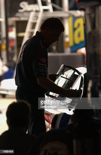 A member of the Miller Lite Ford Taurus team installs the window during practice for the EA Sports 500 at Talladega Superspeedway on October 4 2002...