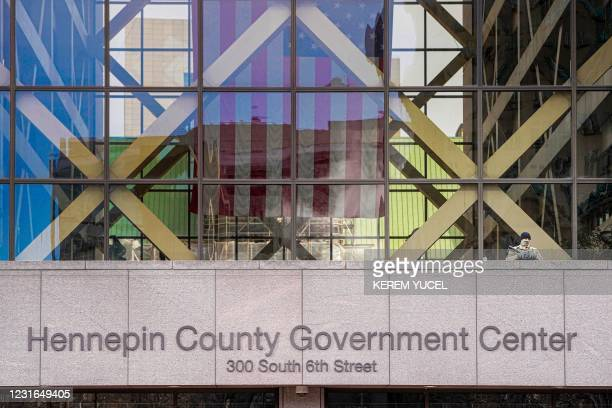 Member of the Minnesota National Guard stands guard outside the Hennepin County Government Center on the third day of jury selection in the trial of...