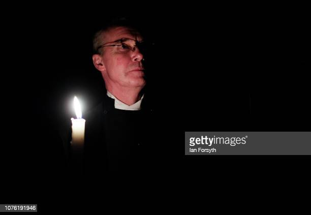 A member of the minster staff holds a candle during the Advent Procession at York Minster on December 02 2018 in York England The candlelit service...