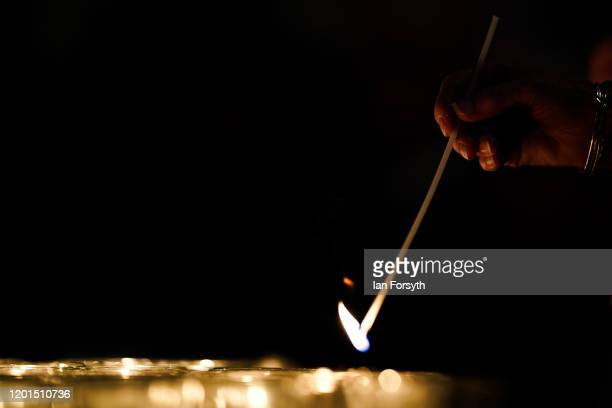 Member of the Minster staff lights candles that are set out as a Star of David on the floor of the Chapter House of York Minster as part of a...