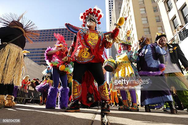 A member of the Mondo Kayo Social and Marching Club parades down St Charles Avenue during Mardi Gras day on February 9 2016 in New Orleans Louisiana...