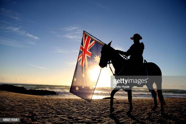 A member of the Mudgeeraba light horse troop takes part in the ANZAC dawn service at Currumbin Surf Life Saving Club on April 25 2014 in Gold Coast...
