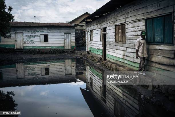 Member of the Muslim community in Goma walks in the flooded courtyard of the Katindo mosque on March 22 in the northeast of the Democratic Republic...