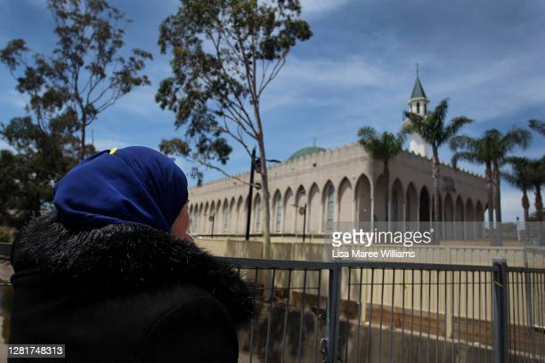 A member of the Muslim community listens to a midday sermon from a distance outside Lakemba Mosque on October 23 2020 in Sydney Australia Religious...