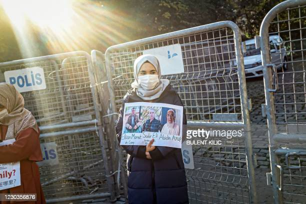 Member of the Muslim Uighur minority holds a placard as she demonstrates in front of the Chinese consulate on December 30 in Istanbul, to ask for...