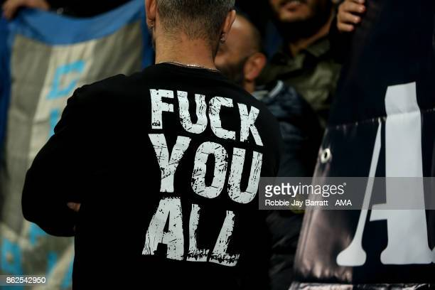 A member of the Napoli Ultras wears a tshirt with explicit language on the back during the UEFA Champions League group F match between Manchester...
