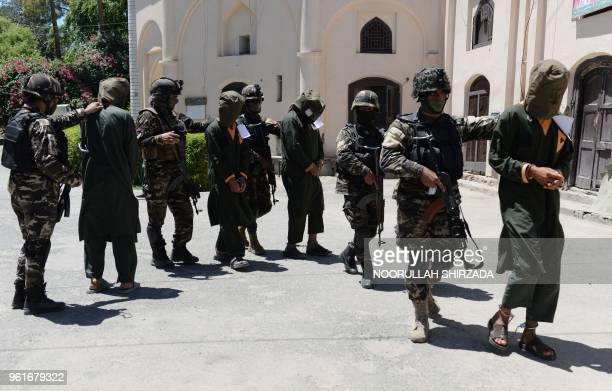 Member of the National Directorate Security escorts alleged Taliban fighters in Jalalabad on May 23 2018 Afghan security forces have detained 13...