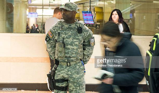A member of the National Guard patrols inside Penn Station on December 31 2014 in New York City With an estimated one million people packing into...