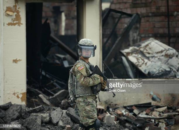 A member of the National Guard patrols near a burned out building on the fourth day of protests on May 29 2020 in Minneapolis Minnesota The National...