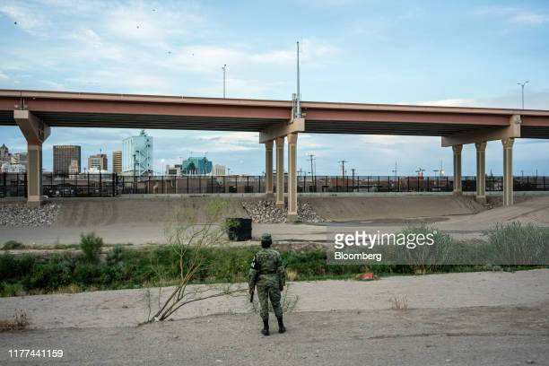 Member of the National Guard patrols the border near El Paso, Texas, in Ciudad Juarez, Chihuahua state, Mexico, on Wednesday, Aug. 28, 2019. Poverty...