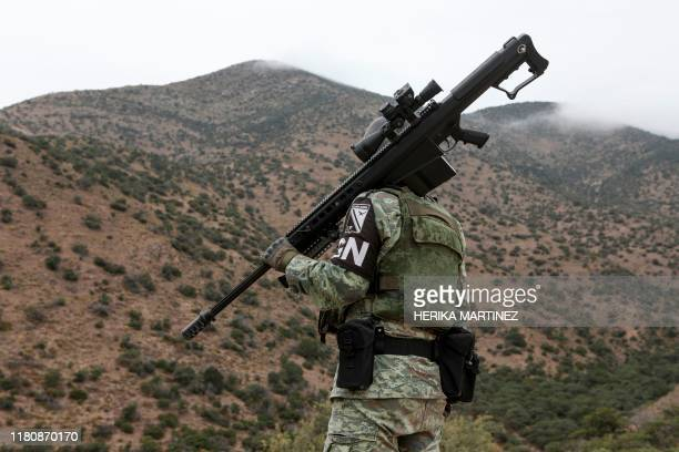 A member of the National Guard patrols the Sonora mountain range where nine members of the LeBaron community were killed on Monday in the...