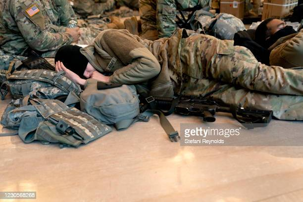 Member of the National Guard sleeps in the Visitor Center of the U.S. Capitol on January 13, 2021 in Washington, DC. Security has been increased...