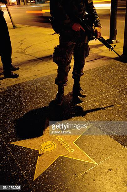 A member of the National Guard stands near Lou Costello's Walk of Fame star during the Los Angeles riots In April of 1992 after a jury acquitted the...