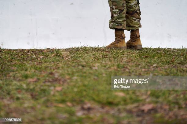 Member of the National Guard stands near the U.S. Capitol on January 17, 2021 in Washington, DC. After last week's riots at the U.S. Capitol...