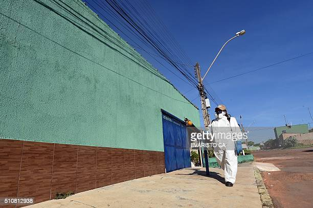 A member of the National Health Foundation fumigates against the Aedes aegypti mosquito vector of the dengue chikungunya fever and zika viruses in...
