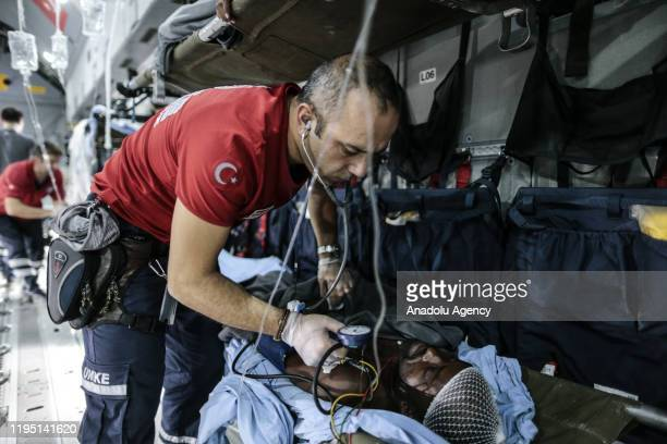 Member of the National Medical Rescue Team checks a person, wounded in a suicide car bomb targeted a police convoy escorting Turkish contractors in...