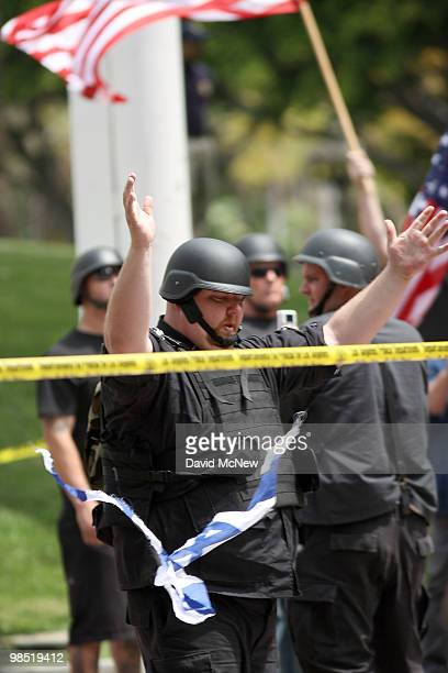 A member of the National Socialist Movement rips up a flag of Israel during an NSM rally near City Hall on April 17 2010 in Los Angeles California An...