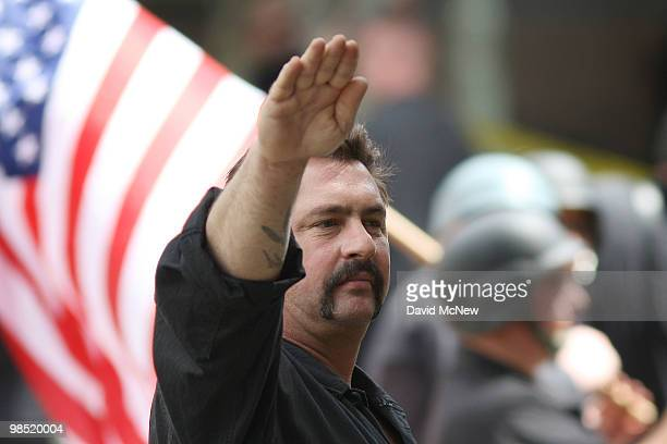 A member of the National Socialist Movement salutes during a rally near City Hall on April 17 2010 in Los Angeles California An NSM antiillegal...