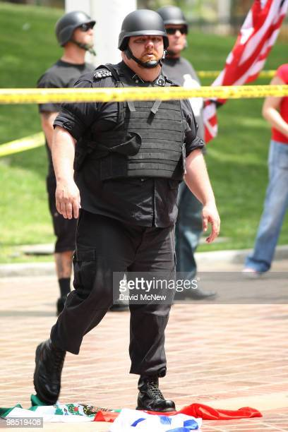 A member of the National Socialist Movement stomps on flags of Israel and Mexico during an NSM rally near City Hall on April 17 2010 in Los Angeles...
