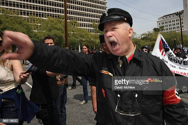 A member of the National Socialist Movement yells as he leaves an NSM rally on April 17 2010 in Los Angeles California An NSM antiillegal immigration...