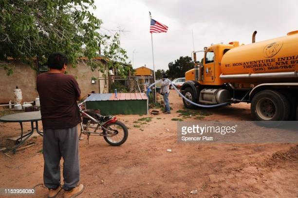 A member of the Navajo Indian tribe waits for his water tank to be filled on June 05 2019 in Thoreau New Mexico Due to a legacy of poverty...