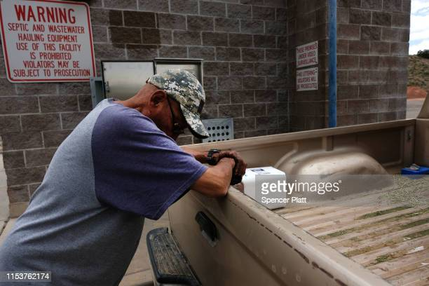 A member of the Navajo Nation fills up canisters with water a public water pump on June 04 2019 in Gallup New Mexico Due to a legacy of poverty...