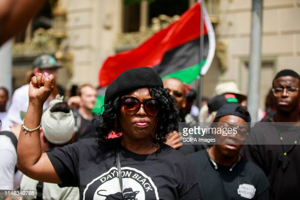 Member of the New Black Panthers makes a Black Power fist while protesting against the KKK. Hundreds of counter protesters, including the Nation of...