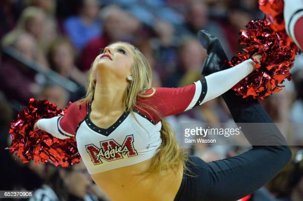 A member of the New Mexico State Aggies dance team performs during the championship game of the Western Athletic Conference Basketball tournament...