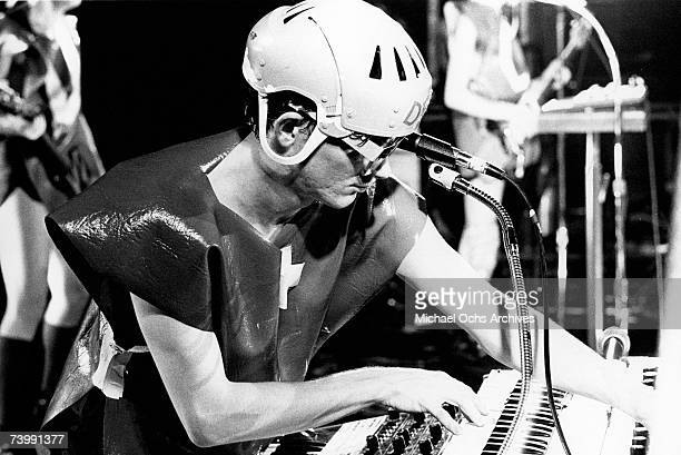 A member of the new wave punk music group Devo wears a mask and costume as he performs onstage in circa 1979 in Los Angeles California